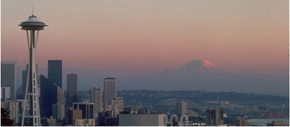 The Seattle Space Needle and Mt Rainier keep watch over the Puget Sound Region